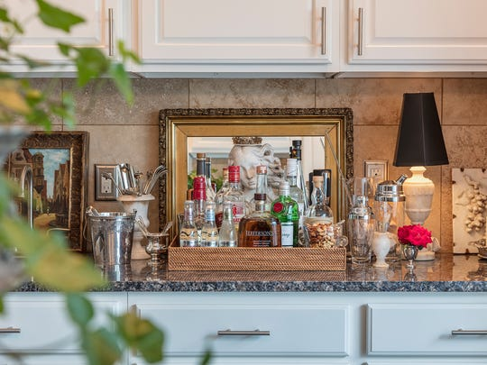 A beautifully styled bar is always at the ready in the kitchen, so guests can help themselves. (Bob Greenspan/TNS)