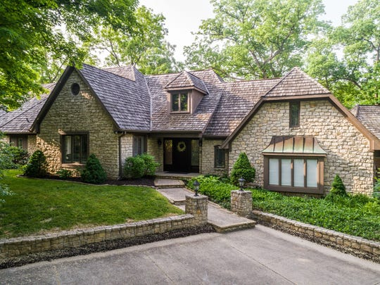 The five-bedroom home at 10421 Fall Creek Road is on the market for $835,000.