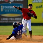 Voyagers shortstop Victor Velasquez throws to first on a double play attempt after recording the out on Missoula Osprey baserunner Raymel Flores on Wednesday night at Centene Stadium, July 1, 2015.
