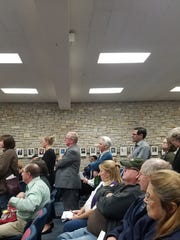 A long line of people wait to speak during a public hearing Oct. 17 regarding the St. Camillus campus expansion proposal.