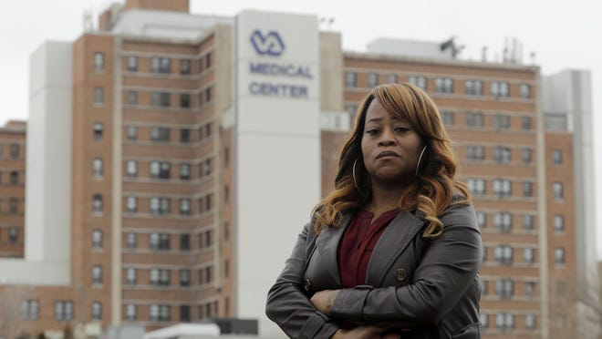 Shominicia Banks stands in March in front of the Kansas City Veterans Affairs Medical Center where she worked as a nurse assistant before being fired earlier that month. Banks is one of about 50 Black employees who have complained about widespread discrimination at the hospital.