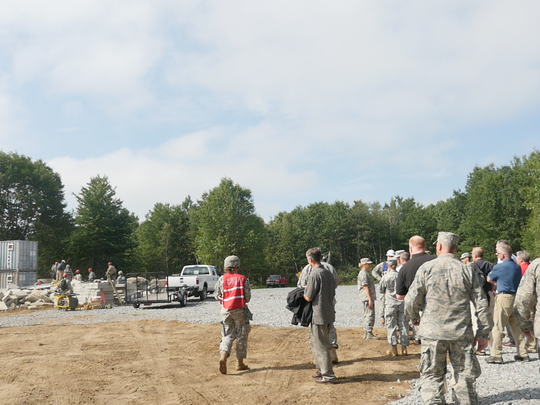 Generals and other military officials look on as the Vermont National Guard works through a simulated search and rescue exercise.