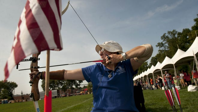 Debra Freed, a U.S. Air Force veteran from Framingham, Massachusetts, competes in the archery competition during the National Veterans Wheelchair Games on Aug. 16, 2014, at Moorestown High School. One reader wonders why the trapshooting event wasn't featured in the newspaper.