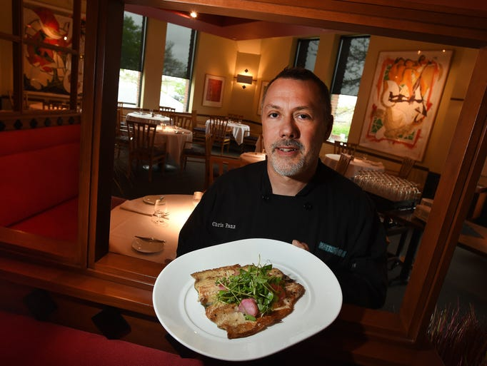 The Rattlesnake Club executive chef Chris Franz holds