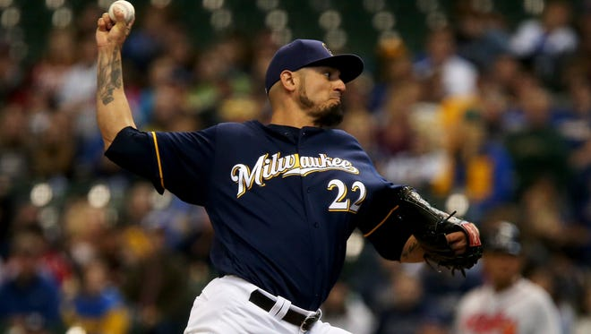 Matt Garza pitches in the first inning against the Atlanta Braves.