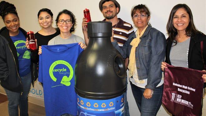 Green Team members, from left, Tarkeysha Burton (SCSWA), Elizabeth Cuevas, Lilia Melendrez, Ramon Quiraga, Irene Holguin (KDACB) and Sylvia Schapekahm with one of the large bottle-shaped recycling bins,