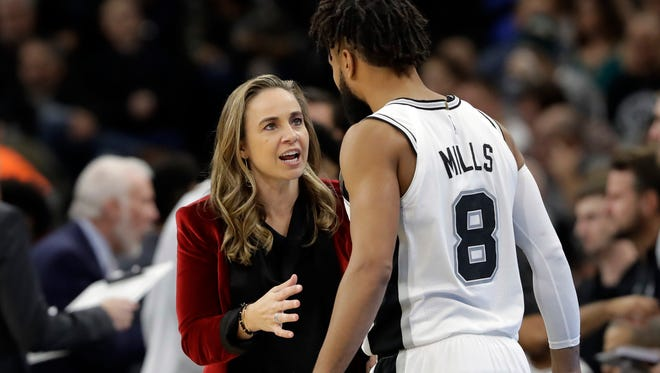 San Antonio Spurs assistant coach Becky Hammon, left, talks with guard Patty Mills (8) during the second half of an NBA basketball game against the New York Nets, Tuesday, Dec. 26, 2017, in San Antonio. San Antonio won 109-97.
