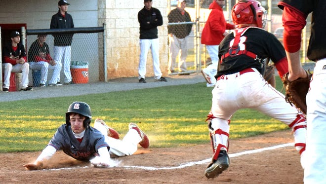Riverheads' Adam Painter slides home with the go-ahead run on a single by Elijah Dunlap in the seventh inning of the Gladiators' 2-1 win over the Cougars in Shenandoah District action on Friday, April 20, 2018, at East Rockingham High School in Elkton, Va.