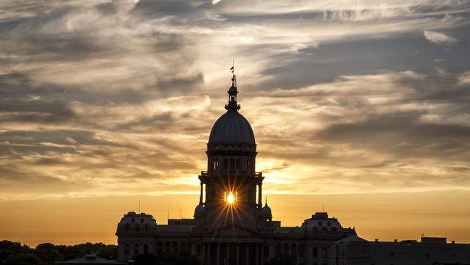The dome of the Illinois Capitol in Springfield is seen in this 2017 file photo taken at sunset.