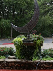 A crescent moon sculpture greets those that arrive at The Crescent Hotel.