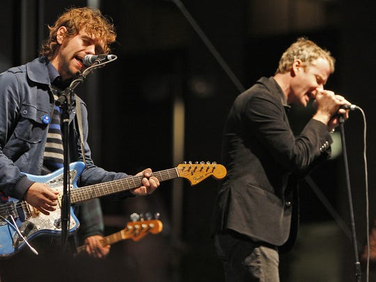 Aaron Dessner (left) and Matt Berninger of The National perform at The Vote Early, Rock Late concert to support Barack Obama on Fountain Square in 2008.
