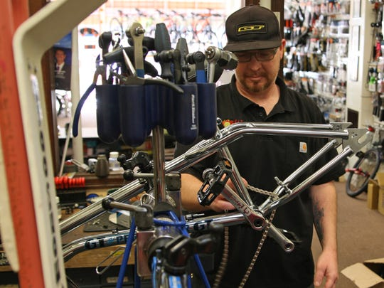 Kenny Trammell works on  a bike at Valley Bikes, 64. W. Alisal Street