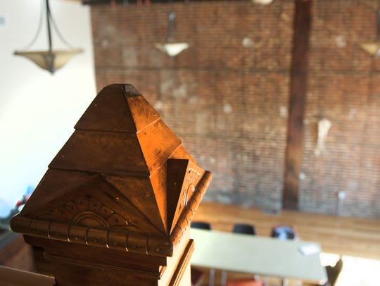 Wood trim stair columns are shown inside Camden FireWorks,