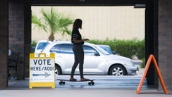 Tori Jensen, 18, rides her long board to vote at Parkway