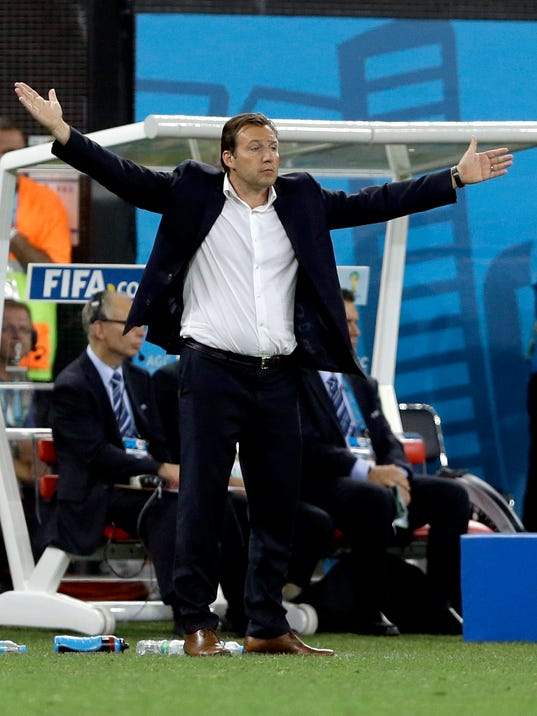 Belgium's head coach Marc Wilmots reacts during the group H World Cup soccer match between South Korea and Belgium at the Itaquerao Stadium in Sao Paulo, Brazil, Thursday, June 26, 2014. Belgium defeated South Korea 1-0. (AP Photo/Kirsty Wigglesworth)