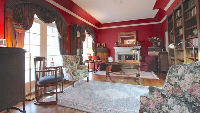 This south Shreveport home at 419 Regency Blvd. features a parlor and study with stained wall bookcase.