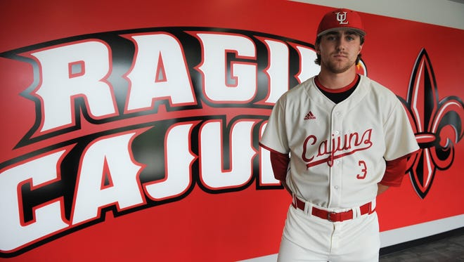 UL pitcher Wyatt Marks models the baseball jersey the Cajuns will wear Friday night against Appalachian State, honoring ex-UL and ex-New York Yankees pitcher Ron Guidry.