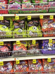 Racks of Halloween-themed candy line shelves at the