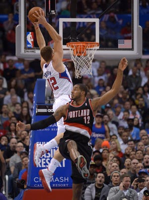 Clippers forward Blake Griffin dunks on Blazers forward LaMarcus Aldridge during Wednesday's home win.