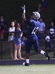 Powdersville junior Tay Cureton (13) points up after