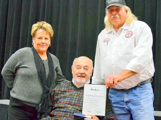 "A 30-year award went to Kendall ""Bunker"" Perryman, who is retiring at the end of the month. His award was presented by Village Manager Debi Lee and mayor Tom Battin."
