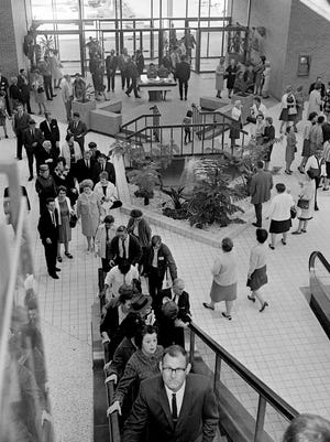 The first shoppers after the grand opening of the 100 Oaks Shopping Center Oct. 26, 1967 are taking advantage of the many opening day sales.