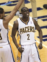 Pacer Darren Collison celebrates a score off a drive down the middle in traffic in the fourth quarter with teammate Leandro Barbosa. Indiana and Miami faced off at Bankers Life Fieldhouse in game four of the NBA Eastern Conference Semifinals Sunday, May 20, 2012.