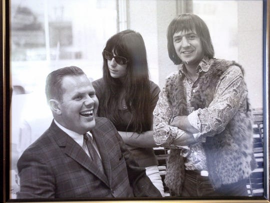 Ed Dougherty in a framed photograph with Sonny & Cher that once hung in his office of his South Salem home.