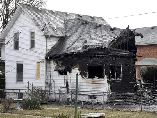 A home, damaged by a fire, is seen March 8, 2019, in Monroe. Authorities say over a dozen cats are believed to have died in the southeastern Michigan house fire. The cause is under investigation.