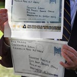 Sen. Patrick Leahy holds enlarged images of envelopes containing anthrax addressed to him and to Senate Majority Leader Tom Daschle, Washington, D.C., Nov. 17, 2001.