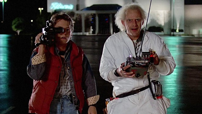 Michael J. Fox (left) and Christopher Lloyd in 1985?s classic ?Back to the Future.? Nearly three decades after its initial release, the film is still considered a science-fiction masterpiece.   Universal Pictures Michael J. Fox (left) and Christopher Lloyd in a scene from the 1985 classic 'Back to the Future.'  Credit: Universal Pictures.