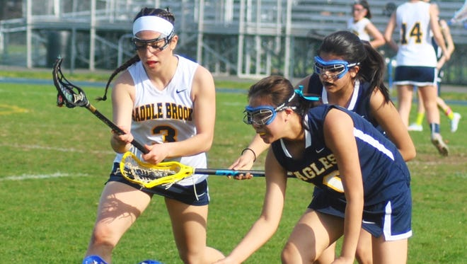 Saddle Brook's Brooke Costanzo (left) had six goals and eight assists to start the season.