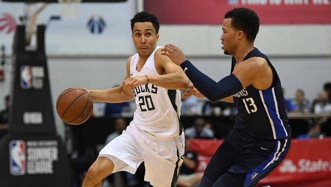 Bucks guard Travis Trice dribbles away from Dallas Mavericks guard Jalen Brunson during the second half on Sunday. Trice lead the Bucks with 16 points.