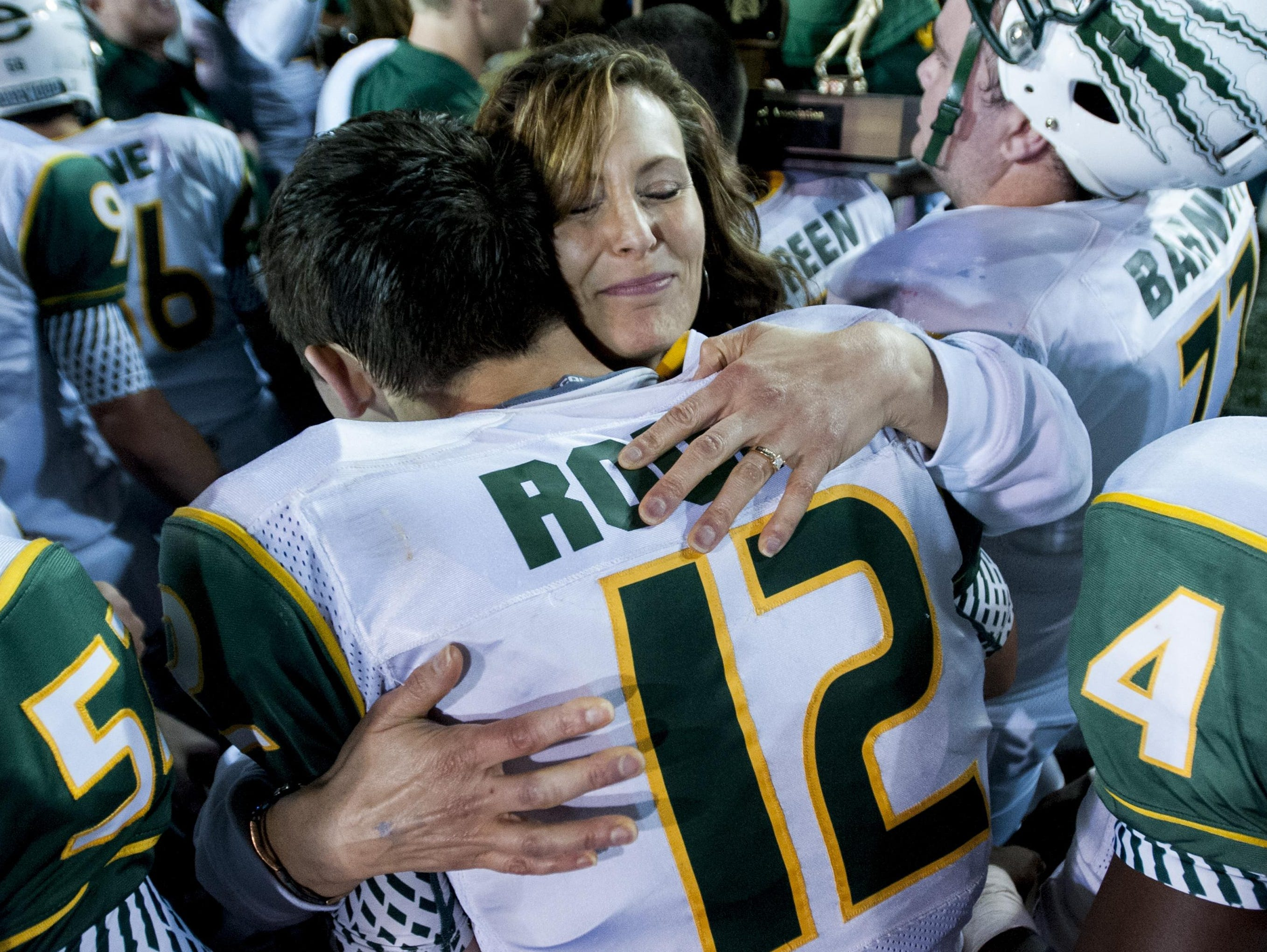 Edgewood's Nathan Rourke is hugged by his mother Robyn Rourke after Edgewood beat Marengo Academy at the AISA State Championships in Troy on Friday.