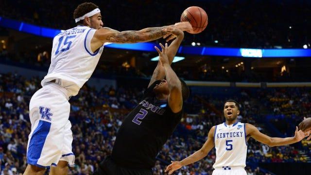 Kentucky Wildcats forward Willie Cauley-Stein (left) blocks a shot ky Kansas State Wildcats guard Marcus Foster.