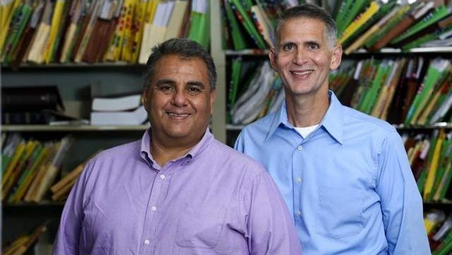 In this July 26, 2013, file photo, Greg Bourke, (right) and Michael Deleon filed a federal lawsuit asking for Kentucky to recognize same sex marriages.