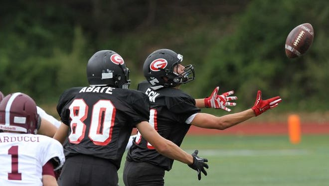 Rye defeated Harrison 24-13 to win the annual Rye-Harrison game at Rye High School Sept. 13, 2014.
