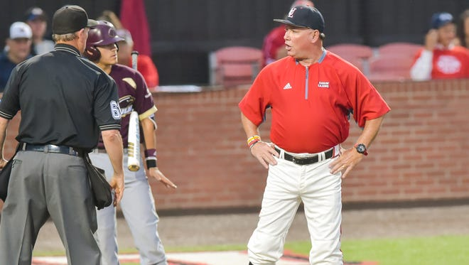 "Coach Tony Robichaux, still chasing a national title in his 22nd season at UL, argues a call during a game against UL Monroe earlier this month at M.L. ""Tigue"" Moore Field."