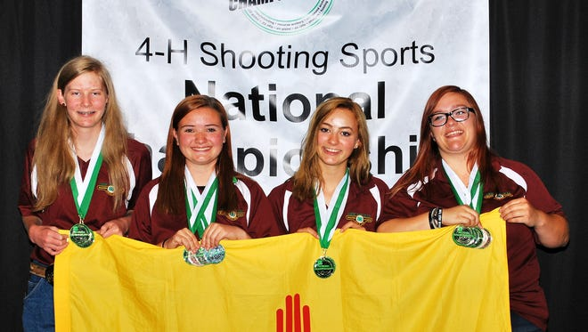 From left, Jeana Dolan, Michaela Langlitz, Rashel Korte and Kimberly Hull, members of the an Juan County 4-H Air Rifle team, pose for a photo at the 4-H Shooting Sports National Championships in Grand Island, Neb. The team won first place at nationals.