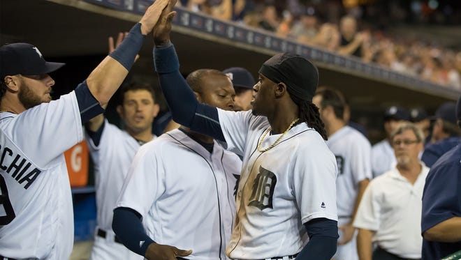 Cameron Maybin of the Detroit Tigers score a run in the bottom of the sixth inning and celebrates with teammates in the dugout during a MLB game against the Houston Astros at Comerica Park on July 30, 2016 in Detroit, Michigan.