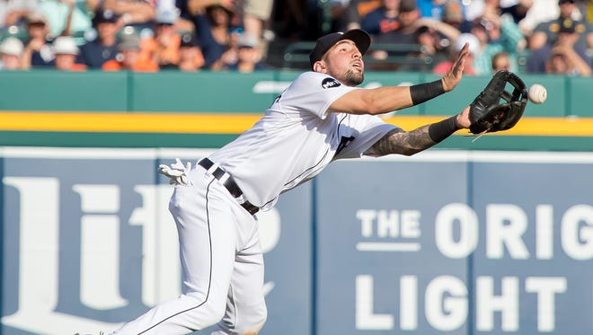 Tigers third baseman Nick Castellanos drops a pop up in the seventh inning against the Dodgers at Comerica Park on Aug. 19, 2017. The error helped the Dodgers break a 0-0 tie in a 3-0 win.