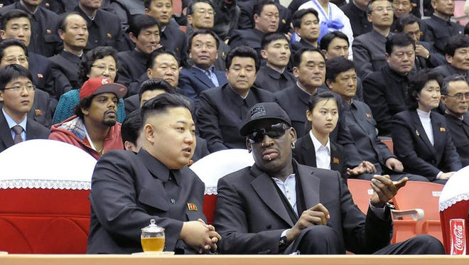 North Korean leader Kim Jong Un and former NBA star Dennis Rodman attend a basketball game in Pyongyang on Feb. 28.