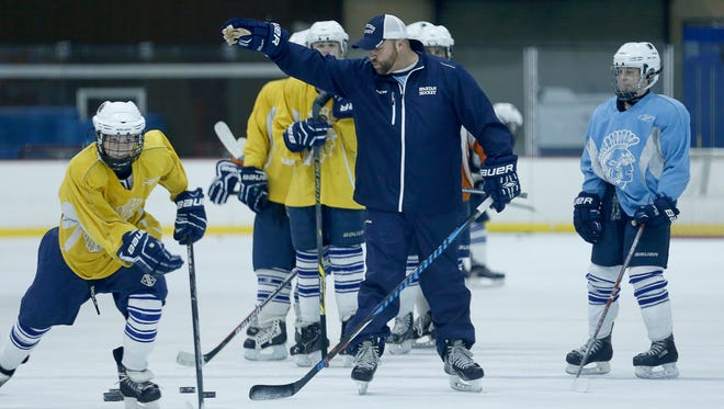 Head coach Joe Jehlen with the players during practice with the Gates Chili/Wheatland-Chili hockey team at Genesee Valley Ice Rink.