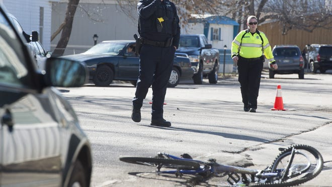 Responders set up an investigation at the scene of a hit and run at Hickory Village after a vehicle collided with a cyclist Wednesday, February 24, 2016.
