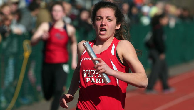 Whippany Park junior Gina Dello Russo crosses the finish line of the 4x100 at Dodgertown Relays.