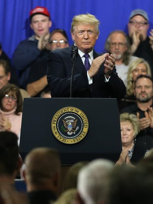 U.S. President Donald Trump claps at the conclusion of a tour and speech at Sheffer Corporation, Monday, Feb. 5, 2018, in Blue Ash.