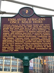 A historical marker at the northeast corner of Front