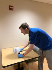 Ben Hack, 19, is enrolled at REED Academy in Oakland NJ, a private school for individuals with autism. As part of REED's Structured Learning Experiences Program (SLE), Ben gathers his supplies as part of his onsite job experience at Valley Hospital in Ridgewood, NJ.