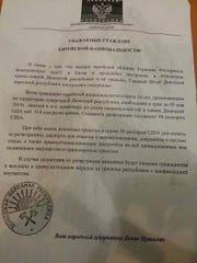 A leaflet distributed in Donetsk, Ukraine, calls for