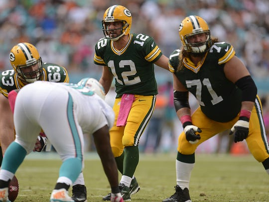 Green Bay Packers guard Josh Sitton, right, is questionable for Sunday night's game against the Chicago Bears at Lambeau Field.